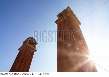 Torres Venecianes In The Sunlight . Two Towers On The Placa De Espana In Barcelona
