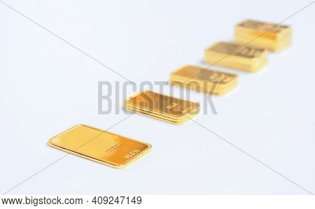 Ladder Made Of Gold Bars. Gold Ingot On A Light Background