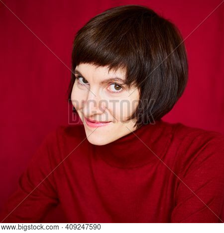Smiling Mature Brunette Woman Looking Playful And Defiant, Close-up Face Portrait Of Middle-aged Lad