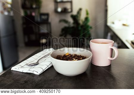 Pink Coffee Cup, Bowl With Chopped Tropical Fruits Kiwi And Banana, Blueberries, Spoon Spoon On Towe