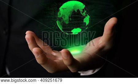 Human Hand Holding Earth Globe Holographic Technology . Futuristic Visualization For Virtual Reality