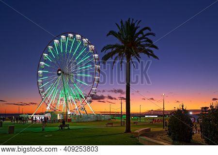 Adelaide, South Australia - February 22, 2021: Glenelg Mix102.3 Giant Ferris Wheel At Moseley Square