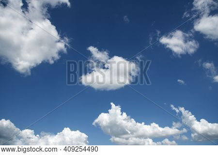 Blue Sky Fluffy White Clouds On Summer Season Bright Clear Skyline With Beautiful Cloudscape. Panora
