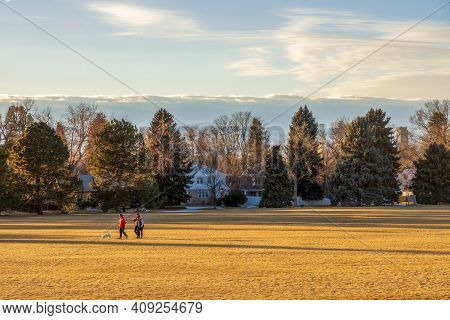 Denver, Colorado - February 19, 2021: People Enjoying A Beautiful Sunset In Cranmer Park, Denver, Co
