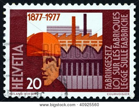 SWITZERLAND - CIRCA 1977: a stamp printed in the Switzerland shows Worker and Factories, Centenary of Federal Factories Act, circa 1977