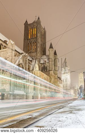 In The Early Morning You Can See The Belfry And Saint Bavo Cathedral Of Ghent Here During Snowfall