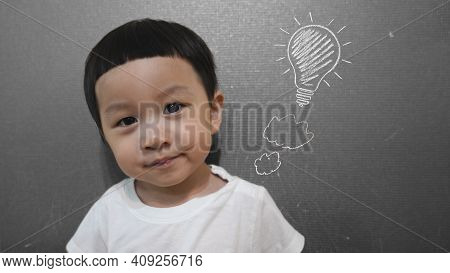 Portrait Of Kid Looking At Camera With Smiling Face. Close Up Shot Of Little Child  Smiling With Thi