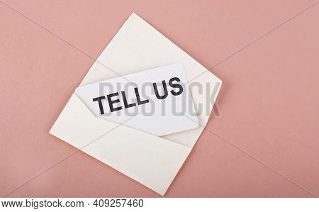 Word Writing Text Tell Us On Card On Pink Background