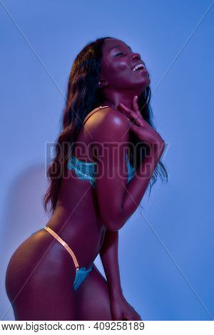 Cheerful African American Young Female Model With Fit Body Having Fun While Posing In Sexy Lace Ling