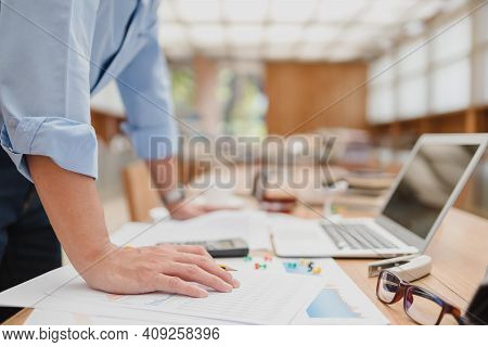 Businessman Stand Up And Reading Paper Graph And Checking Document Data Calculator For Calculate Bud