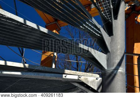 A Metal Lattice Grate Is Used For The Outdoor Spiral Staircase. The Galvanized Grate Is Transparent