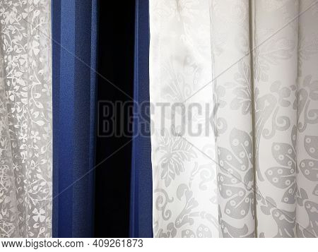 Blue And White Curtains, Blackout Curtains And Tulle. Close-up. Cotton Fabric Background Texture. In