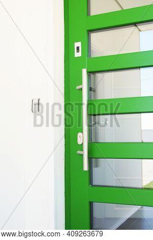 Entrance Door, Front Door With Electromagnetic Lock Installed. A Green Door With A Magnetic Lock As