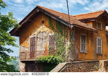 View Of One Of The Old Historic Houses In An Abandoned State In The Bergamo In Northern Italy. Berga