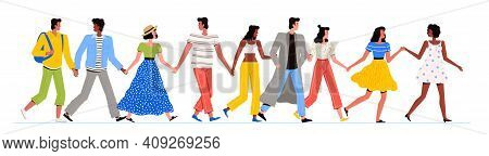 A Group Of Multiracial People Are Walking Together. Men And Women Of Different Nationalities Walk To
