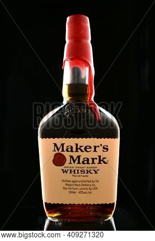 IRVINE, CA - JANUARY 15, 2015: A bottle of Maker's Mark Whiskey. The first bottle of Maker's Mark was bottled in 1958 and featured the brand's distinctive dipped red wax seal.