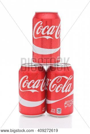 IRVINE, CALIFORNIA - JULY 10, 2017: Three Coca-Cola Cans with condensation. Coke is the most popular carbonated soft drink in the world.