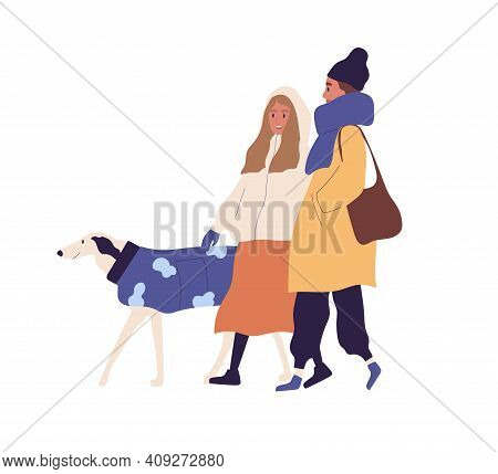 Happy People Walking With Dog In Winter Time. Scene Of Friends Strolling With Pet Outdoors In Winter