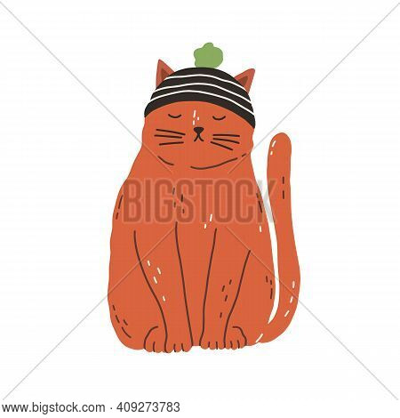 Cute And Funny Ginger Cat Wearing Knitted Hat With Pompom And Sitting With Closed Eyes. Adorable Kit