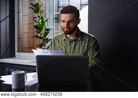 The Image Of A Young Entrepreneur Or Manager Carefully Analyzing The Rate Of Increase Or Decrease In