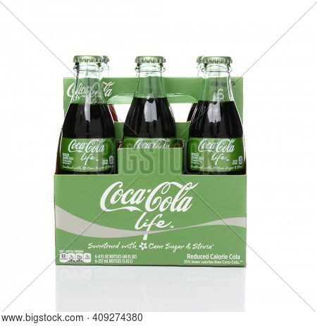 IRVINE, CA - FEBRUARY 15, 2015: 6 pack bottles of Coca-Cola Life side view. A reduced calorie soft drink sweetened with cane sugar and Stevia, containing 60% of the calories of Classic Coke.