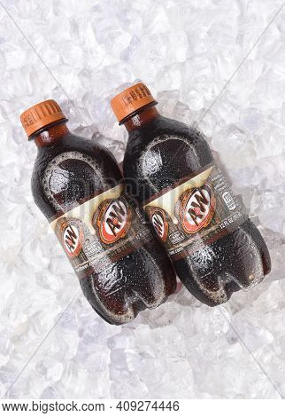 IRVINE, CALIFORNIA - OCTOBER 30, 2017: A and W Root Beer bottles on ice. Owned by Dr Pepper Snapple Group and distributed by the Coca-Cola Company in the USA.