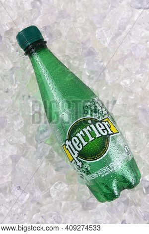 IRVINE, CALIFORNIA - DECEMBER 17, 2017: Perrier Sparkling Mineral Water on ice. The spring, in Vergeze, France, where the water is sourced is naturally carbonated.