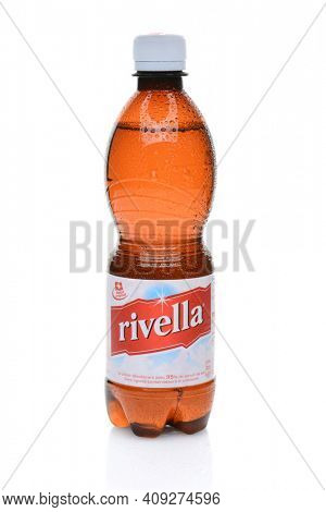 IRVINE, CALIFORNIA - JULY 14, 2014: A bottle of Rivella Red. In 1952, Swiss pioneer Dr. Robert Barth created the wellness beverage based on whey and a secret blend of herb and fruit essences.