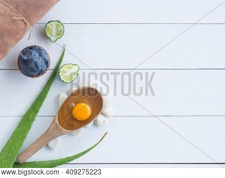 Hair Spa Set. Hair Mud With Egg And Aloe Vera, Bergamot And Towel On Wooden Background. For Healthy