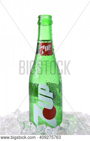 IRVINE, CA - MARCH 12, 2018: A glass 7-Up bottle. A lemon-lime flavored, non-caffeinated soft drink. The rights to the brand are held by Dr Pepper Snapple Group in the USA, and PepsiCo elsewhere.