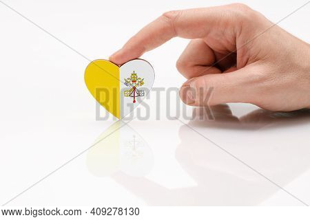 Vatican Flag. Love And Respect Vatican. A Man's Hand Holds A Heart In The Shape Of The Vatican Flag