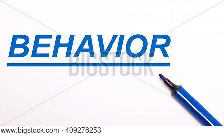 On A Light Background, An Open Blue Felt-tip Pen And The Text Behavior