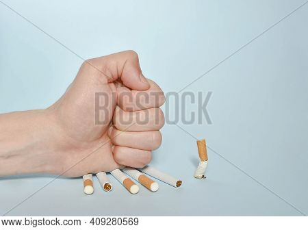 Stop Smoking Concept, Cigarettes And Stop Text On Wooden Blocks. World No Tobacco Day On May 31 Conc