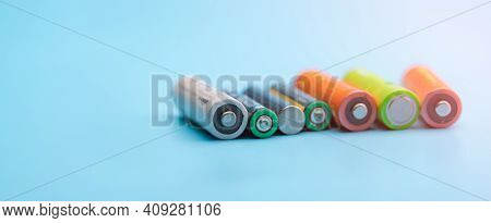 Rechargeable Battery On Blue Background. Selective Focus Negative Terminals Of Rechargeable Lithium-