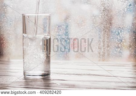 Pour Clean Water Into A Glass, A Stream Of Water Pours Into The Glass.