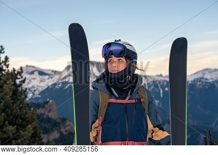Young Skier With Her Off-piste Skis In Winter On A Sunny Day.