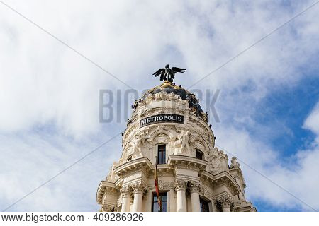 Madrid, Spain - November 1, 2019: Iconic View Of Famous Metropolis Building In Madrid. Sunny Day Aga
