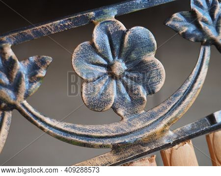 Bronze Flowers And Curls On The Fence. Kuznetsk Craftsmanship. Forged Decorative Metal Parts.