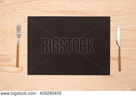 Mockup Blank Card And Cutlery On Wooden Table. Top View Black Recipe Paper A4, A3 Page With Mockup T