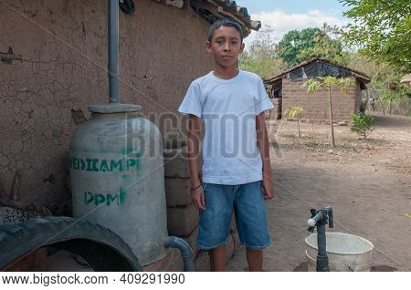Rivas, Nicaragua. 07-15-2016. Portrait Of A Boy In A Rural Area Of Nicaragua. They Have To Walk Long