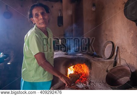 Rivas, Nicaragua. 07-15-2016. Grandmother Cooking At Her House In An Rural Area Of Nicaragua.