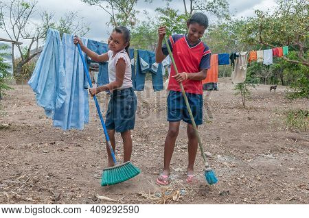 Rivas, Nicaragua. 07-15-2016. Girls Performing Their Duties In Their Farm In An Rural Area Of Nicara