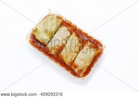 Cabbage Rolls In Tomato Sauce, On A Plastic, Transparent Food Tray, Isolated On White Background. Me