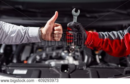 Crop Unrecognizable Businessman Showing Thumb Up Gesture While Standing With Auto Mechanic With Wren