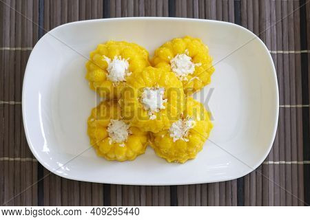 Top View Of Toddy Palm Cake Is Thai Dessert In White Plate On Wooden Table.