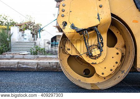 Road Roller Makes The Paving. Road Roller Compacting Asphalt. Roller Compactor On Fresh Asphalt.