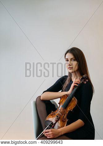 Female Violinist Portrait. Studio Shooting. Classic Music. Musician Player. Artist Hobby. Elegant Ca