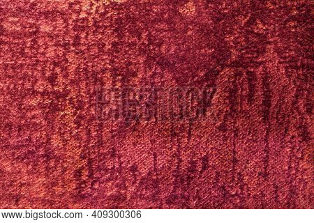Dark Red And Purple Fluffy Background Of Soft, Fleecy Fabric. Texture Of Wine Velveteen Textile Back