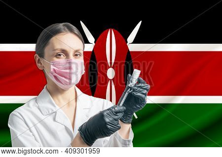 Girl Doctor Prepares Vaccination Against The Background Of The Kenya Flag. Vaccination Concept Kenya