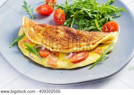 Keto Breakfast. Omelette With Cheese, Tomatoes And Avocado On Light Table. Italian Frittata. Keto, K